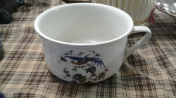 A Victorian floral chamber pot by grimwades