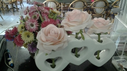 2 Artificial flowers  (one in three heart shaped vase and one in basket)