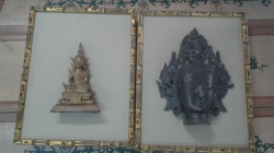 A pair of Asian religious items in frame