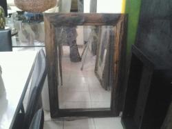 Wood framed mirror 60 x 100 cm.