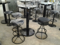 Black round bar table with 3 stools
