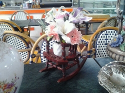 Miniature carved hardwood rocking chair with flowers