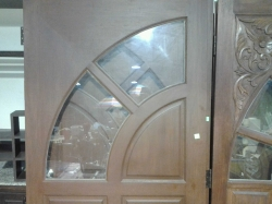 A pair of wooden doors with glass window 99x200cm