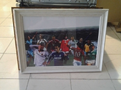 Footballers in photo frame