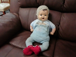 Straw filled jointed doll with mama and closing eyes circa 1930
