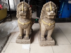 A pair of sand stone Cambodian Lion figures