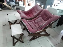 A pair of wood folding chair with cushions and foot stool