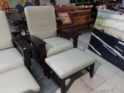 Large brown arm chair with foot stool