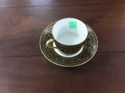 An old antique french limoges cup and saucer