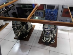 A pair of elephant tables with glass on the top