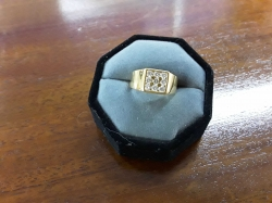 A very nice ladies on gents cold plated ring with nine diamantes stones-stand