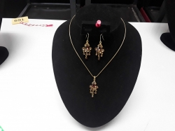 A gold plated lady's necklace with amber stones and matching earrings stand not included