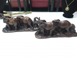 Very nice pair of elephant family ornaments on stand