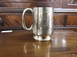 A nice silver plated highly embossed tankard