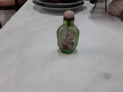 A very nice old snuff glass bottle painted by inside with birds, women and flower design
