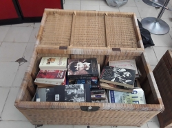 Job lot of books in rattan case