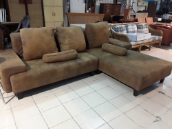 Brown L shape sofa with cushions