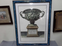 A prints of Roman vase in blue frame