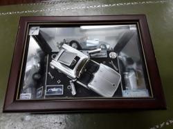 Car model in wood frame