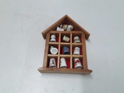 12 thimbles in hanging case