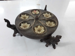 Wooden candle holder with elephants