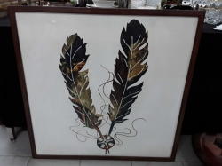 Frame painted of cowboy artifacts