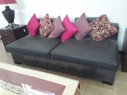 Leather sofa with cushions