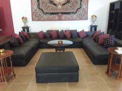 A large leather sofa with cushions