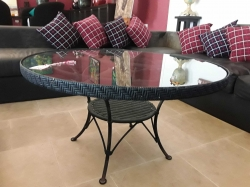 Round coffee table with glass on top