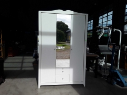 White wardrobe and small safe