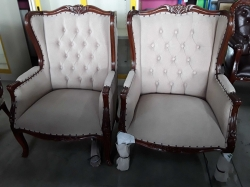 A pair of French wing arm chairs