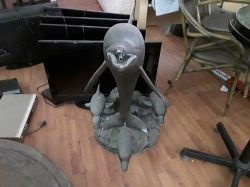 Large heavy bronze dolphins
