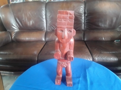 Wooden statue man with broken ear