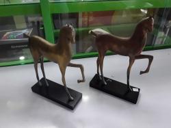 A pair of bronze horses