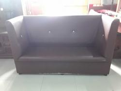 Long brown sofa