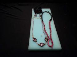 2 Beautiful pendants + earrings