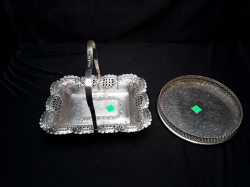 A silver plate square pierced basket & A round gallery tray Georgian style both on feet & both arround 1920s